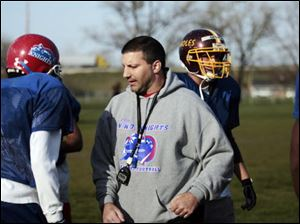 In this 2009 file photo coach Dave Calabrese talks with players of the Northwest Ohio Knights semipro football team during practice.