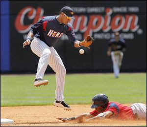 Pawtucket's Matt Sheely steals second as Mud Hens second baseman Argenis Diaz can't handle the high throw from catcher Max St-Pierre