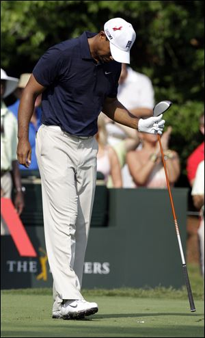Tiger Woods has to use crutches and a walking boot now, but expects to regain strength to play in the U.S. Open in June.