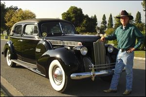 Jim Felt of Glendora, Calif., with his 1940 Packard Super 8 Luxury Sedan, says that once Jerry Brummett's vehicle is fully restored,  it could be worth between $35,000 and $50,000. Mr. Felt said his car, which is a similar model to Mr. Brummett's, has appeared in about a dozen films.