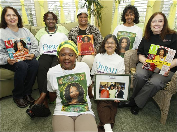 "Members of Oprah's Biggest Fans in Northwest, Ohio, including Earlean ""Cookie"" Belcher, on floor, left, Linda Rodela, on floor, right, and from back left,  Louisa Arce, Brenda McFall, Rose Johnson, Dorothy Clark, and Jackie Arce, gather for a photo at Earlene's home in Maumee."