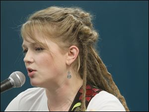 Crystal Bowersox performs for diners at St. Paul's Community Center in Toledo. The center feeds between 150 and 200 lunches each day.