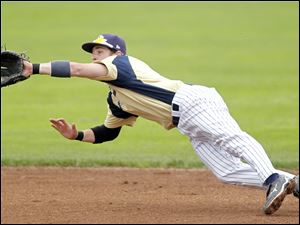 St. John's Jimmy Scott makes a diving catch in the third inning.