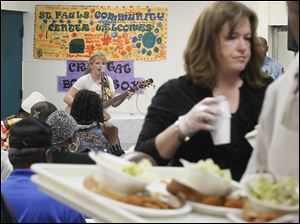 After helping serve lunches, 2010 'American Idol' runner-up Crystal Bowersox performs for diners at St. Paul's Community Center.