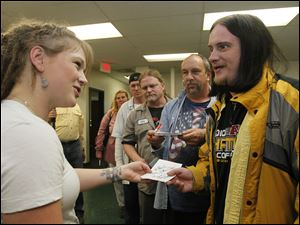 Crystal Bowersox signs autographs after performing at St. Paul's Community Center. Shown are Joshua Smith, front, Bob Dull, Billie Davis, all of Toledo.