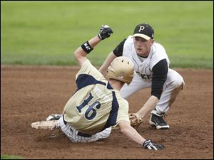 St. John's Dylan Willits steals second base on Perrysburg's Kevin Schenk in the eighth inning.