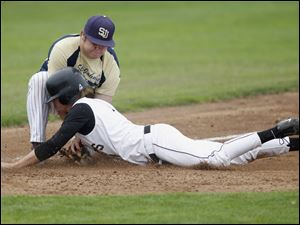 St. John's Ben Nevers tags out Perrysburg's Steve Slocum as Slocum tries to steal third in the fourth inning.