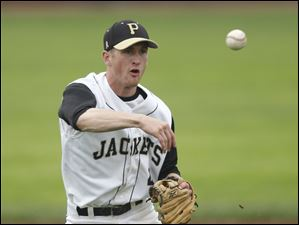 Perrysburg's Kevin Schenk throws to first to record an out in the fourth inning.