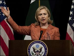 U.S. Secretary of State Hillary Rodham Clinton addresses a news conference Friday at the U. S. embassy in Islamabad, Pakistan.