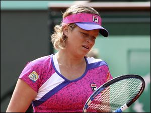 Kim Clijsters tries to compose herself, but she lost 11 of the final 12 games to fall to Arantxa Rus.
