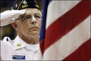 Don Zellner of Christ Dunberger American Legion Post 537 salutes during the 96th annual Memorial Day program at Waite High School. A $2,000 check was presented to Honor Flight of Northwest Ohio.