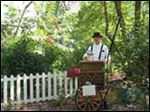 An organ grinder entertains at Roscoe Village in Coshocton, Ohio.