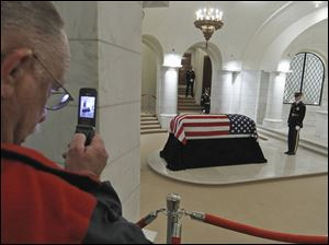 A man takes pictures as the last American veteran of World War I, Army Cpl. Frank Buckles, lies in honor at Arlington's Memorial Amphitheater Chapel at Arlington National Cemetery in Arlington, Va., earlier this month.