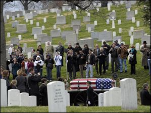 Family and friends attend the burial service for Army Cpl. Frank Buckles, the last American veteran of World War I, at Arlington National Cemetery. Buckles died last month at his Charles Town, W.Va., home at age 110.