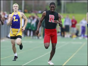 Rogers' DerJuan Gambrell, center right, wins the 400 meter dash during the Division I Regional track meet.