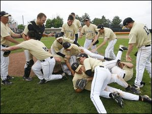 Perrysburg players celebrate after defeating Strongsville.