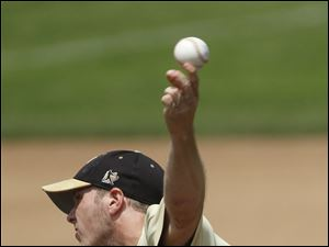 Perrysburg pitcher Matt Kruzel throws against Strongsville High School.