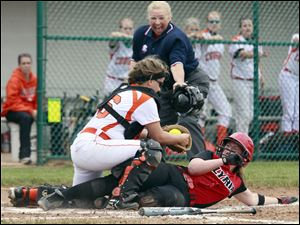 Southview catcher Jess Knepper (16) tags out  Elyria's Melanie Woodard (30) at the plate.