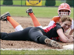 Elyria first baseman Alyssa Barker (3) tags out  Southview's Hanna Gerken (2) during the third inning.