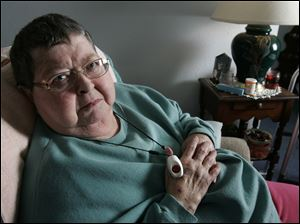 "Shirley Saathoff uses a small panic-button pendant and two-way communication system for her tidy Lee's Summit home. ""It's a godsend, honey,"" said the 72-year-old woman of the device that provides 24-hour monitoring."
