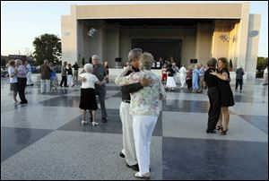 Couples dance the night away at the 70th anniversary celebration of Centennial Terrace in 2009.
