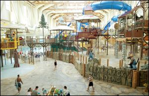 Visitors walk through the indoor water park at Great Wolf Lodge in Mason, Ohio.