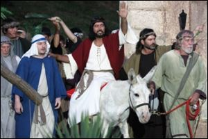 Actors portray Jesus' entrance into Jerusalem in the outdoor drama 'The Living Word.'