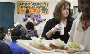 Crystal Bowersox performed for diners at St. Paul's Community Center after helping to serve lunch.
