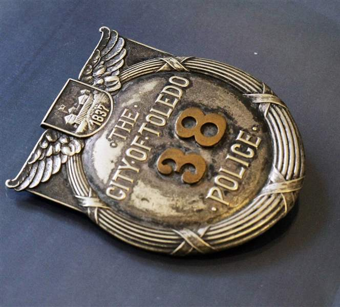 Police-badge-front-industry-design