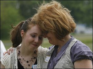 Alexander Drabik's granddaughter, Katrina Wilson, left, and her mother, and  Rita Wilson embrace after the unveiling of the historical marker.
