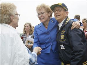 Nelda Reno, left,  Rep. Marcy Kaptur, and Cliff Kujawa, gather as an Ohio Historical Society Marker in unveiled to honor the birthplace of Alexander Drabik.