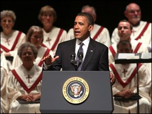 President Obama speaks at a community memorial service at Missouri Southern State University in Joplin, Mo., on Sunday.
