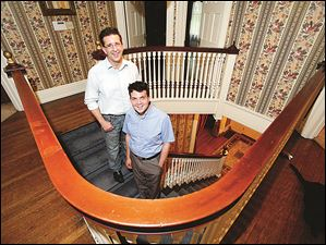 Brian Frauenknecht and Jarid Fitch, right, in their home at 2461 Glenwood Ave.