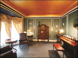 The parlor features in the home of Brian Frauenknecht and Jarid Fitch features a gold flake ceiling.