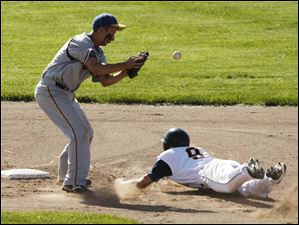 Northwood's Nick Russell misses a throw as Toledo Christian's Cody Gibson slides into second base/
