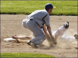 Toledo Christian's Cody Gibson to reach second base safely as Northwood's Nick Russell misses a throw.