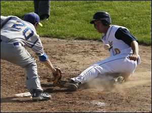 Northwood pitcher Cameron Juhasz misses the tag on Toledo Christian's David Westmeyer during the TAAC baseball championship game at Owens Community College.