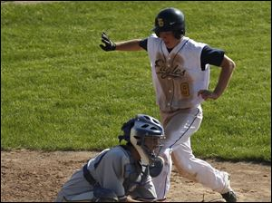 Northwood catcher Evan Perkins waits for the ball as Toledo Christian's Cody Gibson heads for the plate.