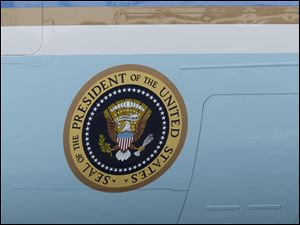 The presidential seal on the side of Air Force One.