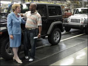 Congresswoman Marcy Kaptur meets with James Fayson, a production operator assembler at the Toledo Assembly complex, during President Obama's visit to the complex.
