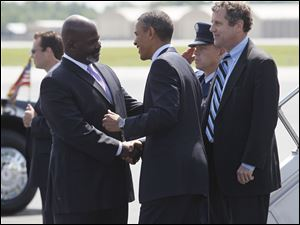 Toledo mayor Mike Bell greets President Obama at Toledo Express Airport.