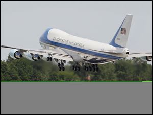 Air Force one takes off from Toledo Express Airport after President Obama visited the Jeep Wrangler plant at Chrysler Group LLC's Toledo Assembly complex, Friday, June 3, 2011.