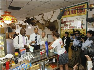 Toledo Mayor Mike Bell, President Barack Obama center, and Gus Dionyssiou at Rudy's Hot Dogs.