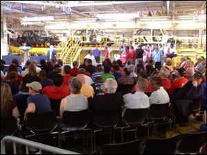 A crowd of mostly union members await President Obama's arrival Friday at the Chrysler Assembly complex.