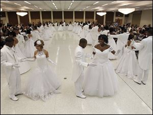 Debutantes and their escorts dance a waltz at the 47th Annual Debutante Cotillion.