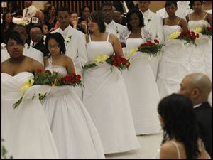 The debutants prepare to dance during the 47th Annual Debutante Cotillion.