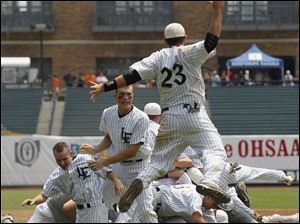 Lakota East players celebrate after beating Perrysburg 6-2 in the Division I state baseball championship game in Columbus.