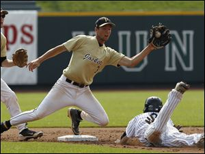 Perrysburg second baseman Alec Schmenk takes the throw as Lakota East's JD Whetsel steals second during the first inning of their  Division I state baseball championship game in Columbus.