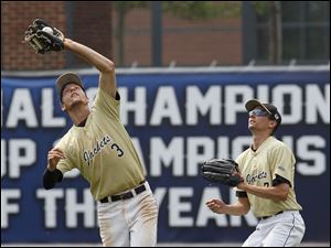Perrysburg second baseman Alec Schmenk catches a fly ball in the fourth inning. Right fielder Ryan Young watches.