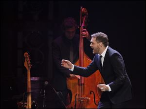 Buble starts one of his signature stage slides.